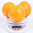 Oranges on scale — Stock Photo