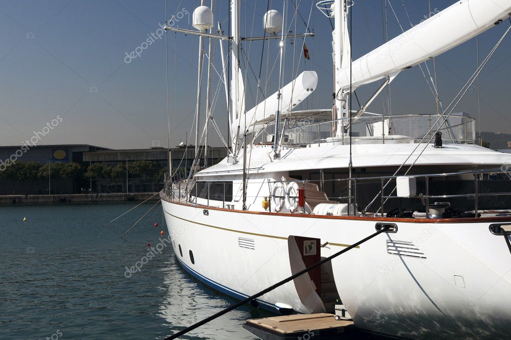 Moored double masted white luxury yacht with sails furled and gangway down for disembarking — Stock Photo #7369213