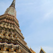 Ancient pagoda with Wat Pho on the background — Stock Photo