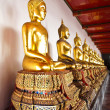 Row Buddhas statue at Wat Pho in Bangkok, Thailand - Stock Photo