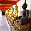 Row of Buddhas statue at Wat Pho , Bangkok — Stock Photo