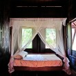 Bed and mattress in a wooden Thai house - Stock Photo