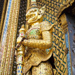 Stock Photo: Golden Statue gaurd giant at Wat PhrKaew