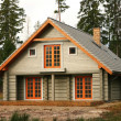 Log lodge in woods — Stock Photo #7716163