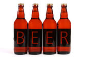Four beer bottles — Stock Photo