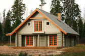 Log lodge in the woods — Stock Photo