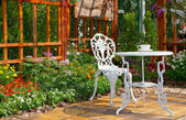 Garden and white chair — Stock Photo