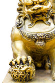 Gold chinese lion statute — Stock Photo
