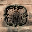 An ornate stone carving on church wall. — Stock Photo