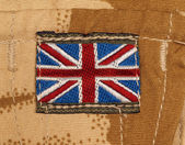 British Army Badge on Desert Camouflage — Stock Photo