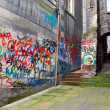 Back alley with graffiti, Edinburgh, Scotland - Stock Photo