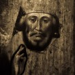 Old icon on wood in sepia tone — 图库照片