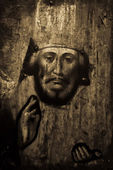 Old icon on wood in sepia tone — Stock Photo