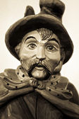 Portrait of night watchman, wooden sculpture — Stock Photo