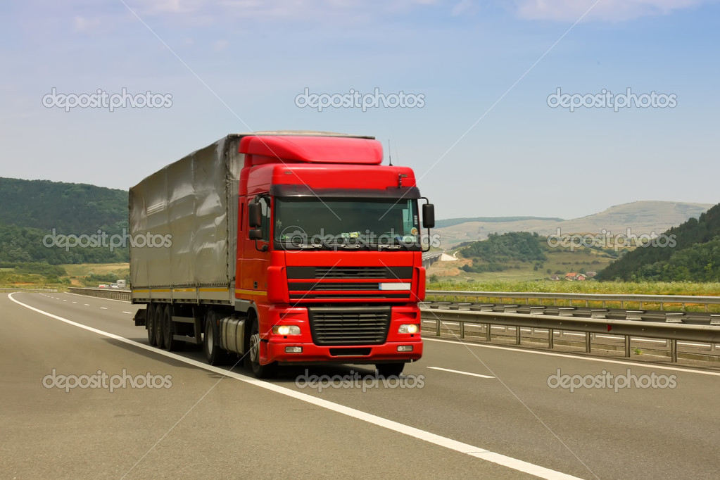 Truck on asphalt road in a summer day — Stock Photo #7934766