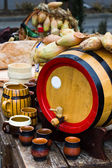Wood barrel with cups — Stock Photo