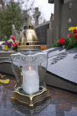 White votive candle on marble tombstone — Stock Photo