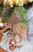 Toy santa at the christmas tree — Stock Photo