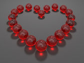 Heart composed from red glass balls — Stock Photo