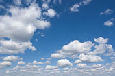 Fluffy clouds — Stockfoto