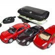 Stock Photo: Three model of car and wallet with money
