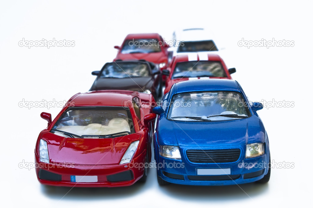Six coloured models of car on white — Stock Photo #7528029
