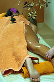 Young Woman and Stone Massage — Stock Photo