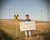 Child against nuclear energy. He protest with sign. — Stock Photo