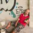 Drunk Man in urban scene. - Stock Photo