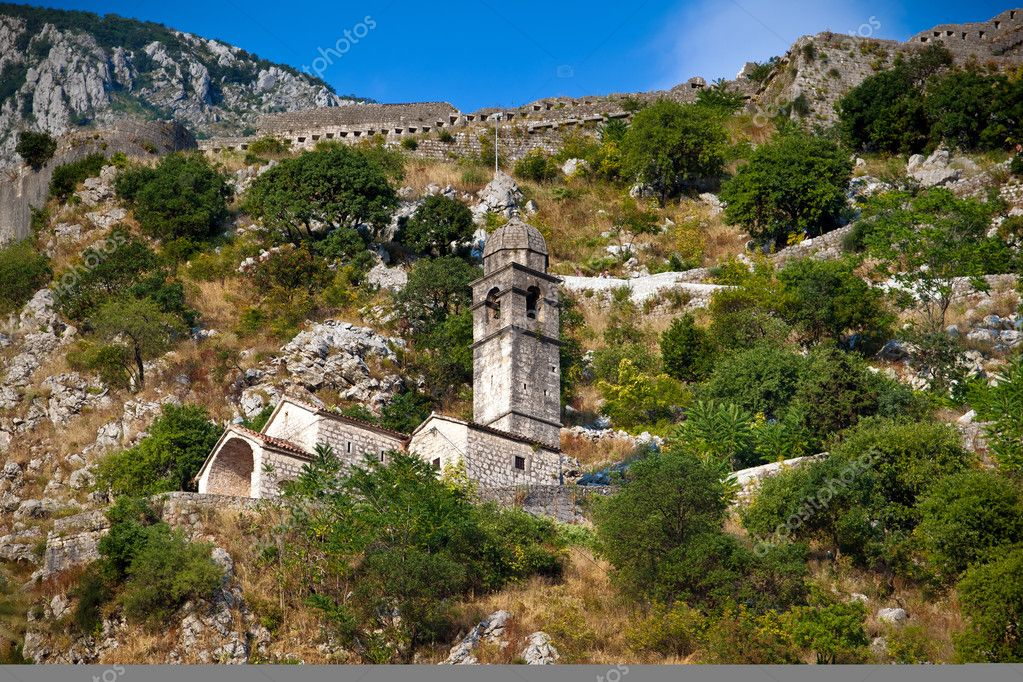 Stone bell tower of Chapel of Our Lady of Salvation above Kotor town and Kotor bay, Montenegro  Stock Photo #6842052
