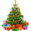 Lush christmas tree with colorful gift boxes — Stock Photo