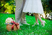 Feet of the groom and the bride — Stock Photo