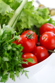 Tomatoes closeup in a salad — Stock Photo