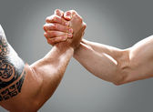 Two musculine male hands making an agreement — Stock Photo