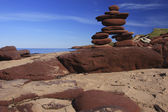 Inukshuk made of Red rocks — Stock Photo