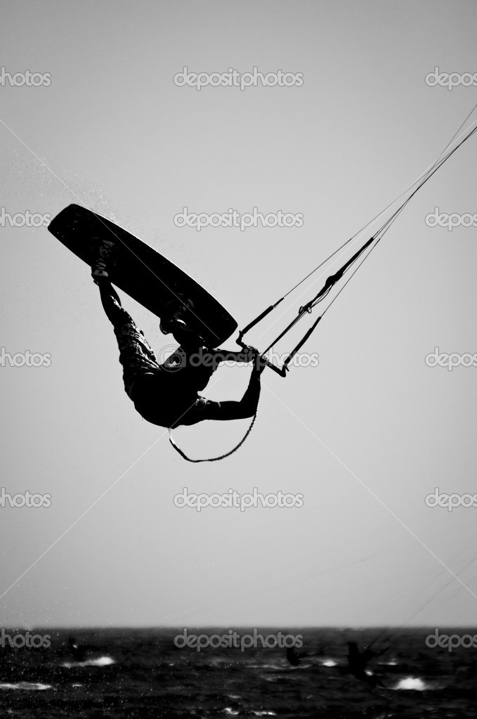 A Silhouette of a kite surfer in a Black & White finish. — Stock Photo #7144382