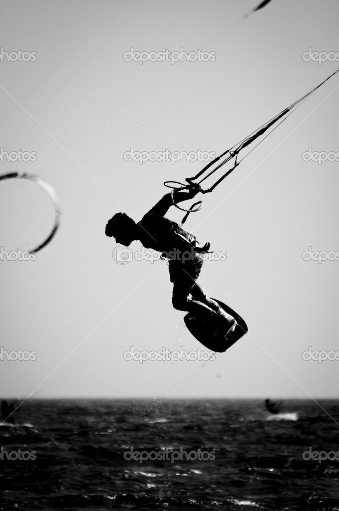 A Silhouette of a kite surfer in a Black & White finish.  Stock Photo #7144412