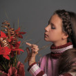 Girl with Christmas flowers — Stock Photo #6939366
