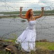 Bride with barbed wire — Stock Photo