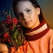 Girl with Christmas flowers — Stock Photo