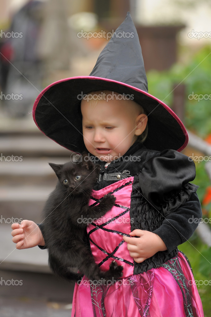 Little witch with a black kitten — Stock Photo #7025723