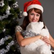 The young woman with a Christmas cap — Stock Photo