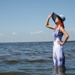 Young fashion woman on the beach — Stock Photo #7314382