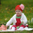 Royalty-Free Stock Photo: The little girl with a water-melon