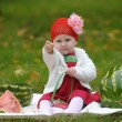 The little girl with a water-melon — Stock Photo