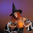 Beautiful red-haired witch — Stock Photo #7445504