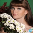 Young woman with daisies — Stock fotografie