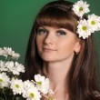 Young woman with daisies - Stock Photo
