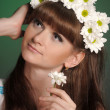 Young woman with daisies — Stock Photo