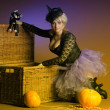 Stock Photo: Witch with cat and pumpkin